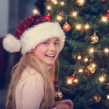 Christmas eve - girl smiling Stock Images