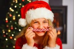 Christmas eve - girl smiling Stock Photos