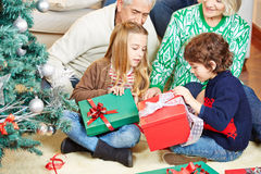Christmas eve with grandparents at home Royalty Free Stock Images