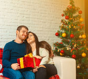 Christmas eve. Happy young family with presents for new year Royalty Free Stock Photography
