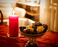 Christmas eve at home, red decor and treats  on the table Royalty Free Stock Image