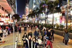 Christmas Eve in Hong Kong. HONG KONG, CHINA - DEC 24, 2012: Christmas Eve in Hong Kong, pedestrian walk on the road instead of vehicles and wait for Christmas royalty free stock photo