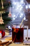 Christmas Eve. Hot drink mulled wine, Christmas background. Alco Royalty Free Stock Photos