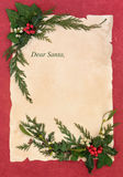 Christmas Eve Letter to Santa. Claus with border of holly and winter greenery Royalty Free Stock Image