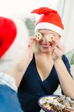 Christmas Eve make funny things Stock Photography