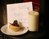 Christmas eve mince pie & milk & letter for Santa Stock Image