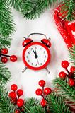Christmas Eve and New Years clock on snow. Christmas Eve and New Years clock at midnight with fir tree branches on snow royalty free stock images