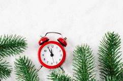 Christmas Eve and New Years clock on snow. Christmas Eve and New Years clock at midnight with fir tree branches on snow royalty free stock image
