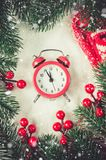 Christmas Eve and New Years clock on snow. Christmas Eve and New Years clock at midnight with fir tree branches on snow. Vintage toned image. Snow effect royalty free stock images