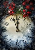 Christmas Eve and New Years at midnight. Clock covered with snow. Christmas Eve and New Years at midnight royalty free stock photos