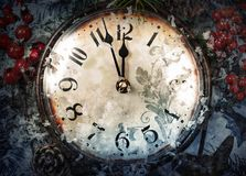 Christmas Eve and New Years at midnight. Clock covered with snow. Christmas Eve and New Years at midnight royalty free stock photography