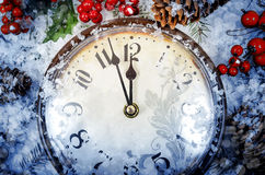 Christmas Eve and New Years at midnight. Clock covered with snow royalty free stock photography