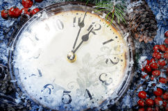 Christmas Eve and New Years at midnight. Clock covered with snow stock photography
