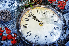 Christmas Eve and New Years at midnight. Clock covered with snow royalty free stock images