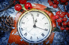 Christmas Eve and New Years at midnight. Clock covered with snow stock photos