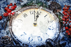 Christmas Eve and New Years at midnight. Clock covered with snow stock images