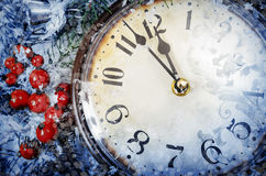 Christmas Eve and New Years at midnight. Clock covered with snow royalty free stock image