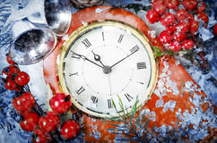 Christmas Eve and New Years at midnight. Clock covered with snow stock image