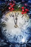 Christmas Eve and New Years at midnight. Clock covered with snow royalty free stock photos