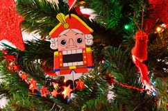 christmas eve and nutcracker with garlands and lights Royalty Free Stock Image