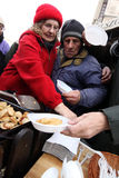 Christmas Eve for poor and homeless on the Central Market in Cracow Royalty Free Stock Photos