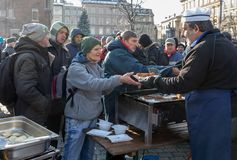 Christmas Eve for poor and homeless on the Main Square in Cracow. Every year the group Kosciuszko prepares the greatest eve in the stock photo