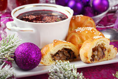 Christmas eve red borscht with pastries Royalty Free Stock Images