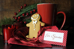 Christmas Eve setting with gingerbread man and coffee Royalty Free Stock Images