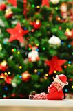 Christmas eve and snowman with garlands and lights Royalty Free Stock Image