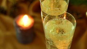 Christmas evening. Champagne in glasses. Candles and a Christmas tree. stock footage