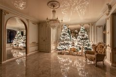 Garland light bulbs. Christmas evening. classic luxurious apartments with decorated christmas tree. Living hall large. Christmas evening. classic luxurious stock photos