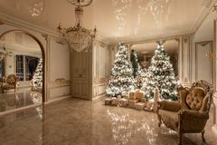 Garland light bulbs. Christmas evening. classic luxurious apartments with decorated christmas tree. Living hall large stock photos