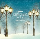 Christmas evening landscape with vintage lampposts. Royalty Free Stock Images