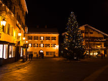 Christmas evening in a village at Austrian Alps Stock Images