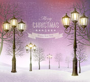 Christmas evening winter landscape with vintage lampposts. Royalty Free Stock Image