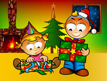 Christmas for ever. Kids opening present for Cristmas Royalty Free Stock Image