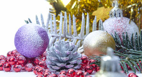Christmas evergreen spruce tree, glass ball and snow Royalty Free Stock Photo