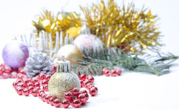 Christmas evergreen spruce tree, glass ball and snow Stock Photography
