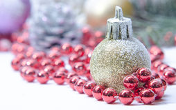 Christmas evergreen spruce tree, glass ball and snow Stock Photos