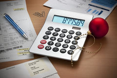 Christmas Expenses Bills Calculator  Royalty Free Stock Photos