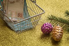 Christmas expenses / concept / brazilian money in shopping cart and christmas decorations Royalty Free Stock Photography