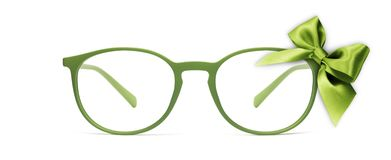 Christmas eyeglasses gift card, green spectacles and green ribbo royalty free stock images