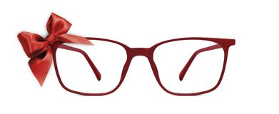 Christmas eyeglasses gift card, red spectacles and red ribbon bo stock photography