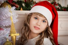 Christmas  face  girl red cap Royalty Free Stock Images