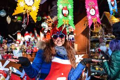 Christmas fair in Baku city, cheerful toy saleswoman Royalty Free Stock Image