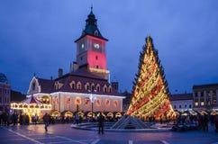 Christmas Fair in Brasov, Romania. Christmas Fair, at dusk, in old city of Brasov, Romania Stock Photos