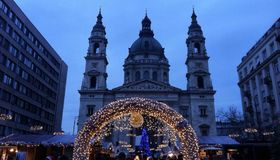 Christmas fair in Budapest. Christmas lights in front of the Saint Stephens Basilica Royalty Free Stock Photo