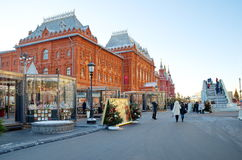 Christmas fair and ice slide in the center of Moscow, Russia. Moscow, Russia - December 20, 2016: The Festival `Journey to Christmas` at the Revolution Square Stock Image