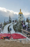 Christmas fair in Kiev, Ukraine. Kids have fun on Christmas fair slides in front of Saint Sophia Cathedral bell tower. Saint Sophia Cathedral is an outstanding Stock Photography