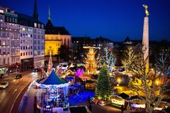 Christmas market. Winter fair with tree and lights. Royalty Free Stock Photos